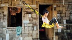 Sanjanai Kharrymba, 6, plays on an upcycled swing outside her home in Mawlynnong, India