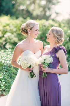 Purple dresses and white bouquet for a cute bridesmaid look. #bridesmaid #bride #weddingchicks Dress By: Watters ---> http://www.weddingchicks.com/2014/04/24/timeless-california-wedding/
