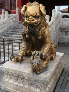 China Beijing The Forbidden City Female Fu Lion (guards baby in paw)