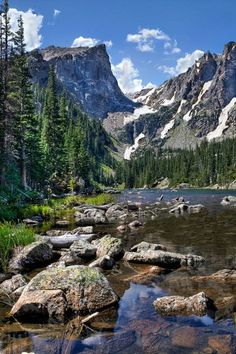 Dream Lake....ROCKY MOUNTAIN NATIONAL PARK....a 265,461 acre park established in 1915 in north-central Colorado....the eastern and westerns slopes of the Continental Divide run directly through the center of the park with the headwaters of the Colorado River in the northwestern region....designated one of the first World Biosphere Reserves in 1976