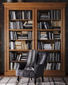 Playing with scale: this pair works together to make a big statement. Pitcured: the Vesey Tufted Club Chair against the Edwardian Bookcase