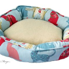 Super soft Snuggle bed can be made in a variety of sizes or to your own specifications with our bespoke service. Made with gorgeous Felix cat fabric in aqua. The inside of the bed is made out of cuddly fleece to offer maximum comfort for your cat. With a line of piping along the top edge to add distinction and definition. There is a concealed zip in the bottom of all sizes, except extra small, so that the base pillow can be removed to make washing your bed easy at 30°c.   Price     € 94.00