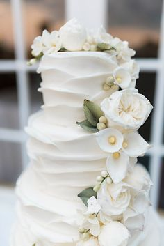 Kelly & Matt's Elegant South Shore Affair via Elegant Productions | White 4 tiered wedding cake with garden roses and calla lily sugar flowers