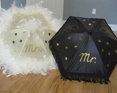 Bride and Groom Wedding New Orleans Second Line Umbrellas- Feather Parasol- Wedding Parade Umbrellas. This umbrella is created to dance, twirl, shake and move! It includes hand painted fleur de lis, a feather boa in your choice of colors, metallic disks or gems, and a fun topper. This umbrella can be created in your choice of colors.  This listing is for TWO MID SIZED umbrellas. The umbrella has 6 panels. It has 3 panels with sequin disks, 1 panels with hand painted Mrs. (white) and Mr…