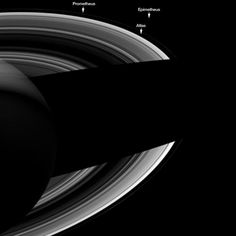 Saturn's Mini-Moons Align for Family Portrait - It's a good thing NASA labeled the moons in this image of Saturn, because they are pretty hard to see. But they are there, keeping each other company in this Cassini spacecraft image of Saturn's night side. And as the Cassini team says, it seems fitting that they should do so since in Greek mythology, their namesakes were brothers.
