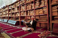 Reading Quran in the library