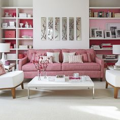 Addition of pink in shelving great wasy to bring colour inhttp://www.thelennoxx.com/browse-by-room/living-room/pink-and-white-living-room/