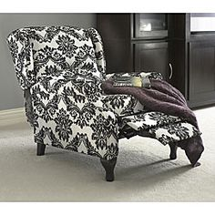 @Overstock - Black and White Recliner. Put your feet up in style with a French-reminiscent black and white wing recliner that simply looks like a classily styled wing chair. The floral print upholstered and well padded seat is 100 percent polyester, and it can hold 220 pounds. http://www.overstock.com/Home-Garden/Black-and-White-Wing-Recliner/4692750/product.html?CID=214117 $314.99