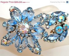 Big Sale Vintage Blue Rhinestone Set Brooch Earrings High End...   https://www.etsy.com/listing/168434215/big-sale-vintage-blue-rhinestone-set