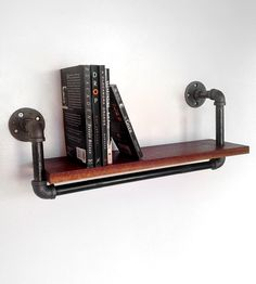 Black walnut and steel wall shelf. I like the industrial/homemade look. -D
