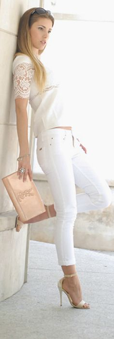 White skinny jeans, white top with lace detail, nude heels and blush clutch