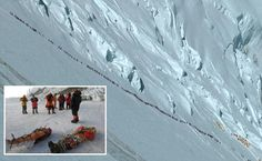 Traffic jam at 30,000 feet: Chilling photo shows bottleneck on Mount Everest as dozens of climbers try to reach summit on weekend when four died