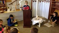 John Paul Lund, 7, leads communal prayer in the atrium at St. Patrick's Parish in Tacoma. Atriums are the sacred spaces where children deepen their relationship with God through the Catechesis of the Good Shepherd's faith formation process. Photo: Courtesy Kim Ward