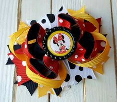 Check out this item in my Etsy shop https://www.etsy.com/listing/465487561/minnie-mouse-bow-minnie-mouse-hair-clip