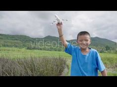 Happy Boy Running With A Airplane (Stock Footage)