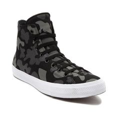 Stand out from the crowd this season with the new camo print Chuck Taylor All Star II Hi Sneaker from Converse! This sweet Chuck II high top sports sturdy canvas uppers with reflective camouflage prints, super soft microsuede lining, and Lunarlon sockliner for lightweight cushion and arch support. Features include: High top style constructed with premium canvas uppers and perforated, microsuede lining for maximum comfort Reflective camo prints that react to direc...