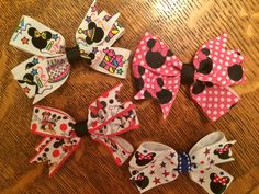 Mickey and Minnie hair bows. https://www.etsy.com/listing/230909117/set-of-small-mickey-mouseminnie-mouse?ref=shop_home_active_5