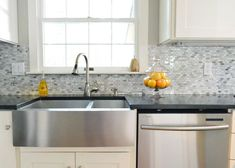 Love the marble tile backsplash. Put a white farmhouse sink instead of the metal. With a single space in the sink instead of two.