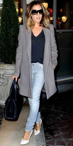 Sarah Jessica Parker In London, a layered a knee-length L'agence coat with a black tee and torn denim. A snakeskin tote and nude Jean-Michel Cazabat heels