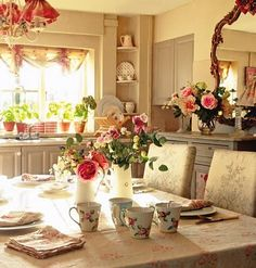 A kitchen filled with roses. What I really like is the use of the old silver backed mirror on the right side, hanging on wall. Mirrors offer such a beautiful way of bringing in even more light!!