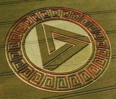 Waden Hill Crop Circle. This crop circle was created in 2005. The field where this crop circle is located overlooks the stone circle of Avebury, and has hosted many enigmatic and controversial formations in years past. This is certainly one to add to that memorable list. The design itself consists of a 'Penrose Triangle' with sides measuring some 126ft in length, surrounded by a circle of laid crop and then an intricate and complex pattern of laid and standing crop around the perimeter.