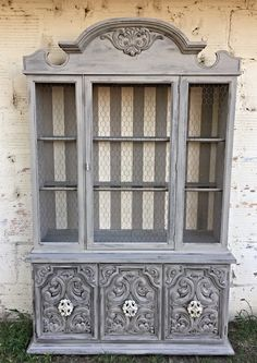 Farmhouse Hutch With Chicken Wire And Striped Background Greige