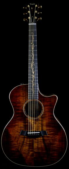 Taylor K24CE Koa. It\'s like staring at perfection until you hear it... then you\'ve really seen perfection.