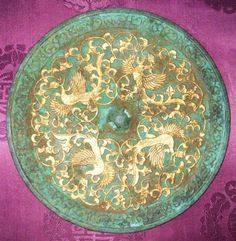 Tang Dynasty bronze mirror.  In addition, the popularization of Taoism in the Tang Dynasty was also reflected by the mirrors with Eight Trigrams. The production of the bronze mirror had declined since the Tang Dynasty.