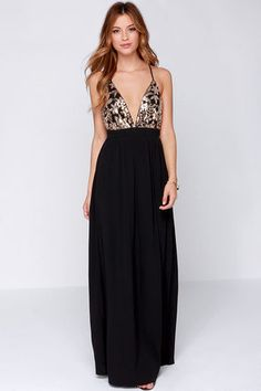 """The price of gold higher than ever, it's no wonder the Lovers + Friends Good as Gold Black and Gold Sequin Maxi Dress has you looking like a million bucks! This black woven maxi has a sultry triangle bodice that's covered in pretty gold sequin patterns. Adjustable spaghetti straps meet a modified racerback with center slit, and a long maxi skirt finishes off this ultra-glam look. Hidden back zipper. Fully lined. Model is 5'7"""" and is wearing a size X-small. Top: 100% Polyester. Bottom: 57%…"""