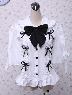 http://www.milanoo.com/product/cotton-white-short-sleeves-bow-decoration-lolita-blouse-p16543.html