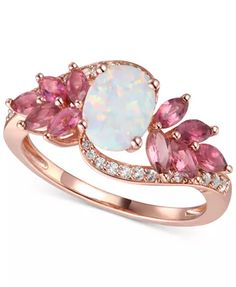 Gorgeous in its breathtaking beauty, this statement ring brings together a stunning opal with pink topaz floral-inspired details and diamonds on the band. Gemstone Engagement Rings, Rose Gold Engagement Ring, Opal Rings, Opal Ring Rose Gold, Opal Promise Ring, Pink Rings, Pink Sapphire Ring, Pink Jewelry, Pink Diamond Jewelry