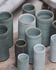 Simple cylindrical vases, thrown from three different weights of clay, turned quickly when leather hard to a relative straight edge and finally fired in a reduction atmosphere. Some take on leads, they have a slight kick to one side that gives them motion and a character they would otherwise not. I usually scatter these across the top layer of the kiln—from right to left they fire very different as the kiln I'm using at the moment only has burners on the righthand side. Not a drastic…