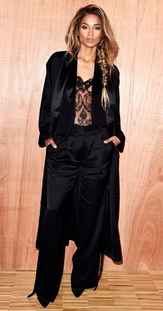 Ciara wears a black silk tuxedo suit and a black lace bustier.