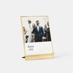 This stand-alone piece artfully combines a solid brass easel with premium quality papers to bring you a beautifully unique desk or tabletop display. Just add 12 of your favorite photos in the calendar design of your choice; gift it or enjoy all year round.
