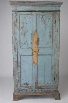 UNUSUAL VALLEY OF VIRGINIA CHIPPENDALE PAINTED CORNER CUPBOARD, two piece cornice with lower dentil molding above two full length double-paneled doors concealing an interior with three fixed shelves, straight-back case returns, the whole raised on an applied base with pierced bracket feet. Surface scraped to older blue paint, interior with cream-color paint.  Oral history indicates a Botetourt C. or Roanoke C., Virginia.  late 18th century. 76 H. x 36 W. x 19 D. case