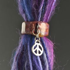 dreadlock bead with a charm by FlameTouchedGlass on Etsy, $20.00