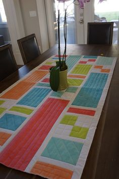 Cindy from Riley Blake Designs takes her column quilt to Norway to add the final stitching! Now that's a tour.
