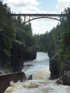 Storstupet @ Orsa Dalarna Sweden. Log driving structure and old railway bridge. Pine trees & Oak barrels