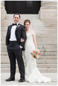 Beautiful bride and groom at the Carnegie Institution for Science in Washington, D.C. Bride's dress by J. Mendel and bouquet in a palette of peachy pink by Petals & Hedges. Image by Birds of a Feather.