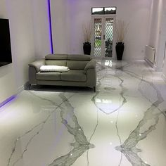 Lounge floor featuring polished Calacatta white marble in a book matched pattern to create an eyecatching and seamless finish. Grey Marble Tile, Calacatta Marble, Marble Print, Marble Floor, White Marble, Large Floor Tiles, Modern Lounge, Marble Effect, Flooring