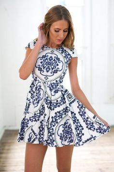 oh so cute!  Paisley print mini dress  High neckline  Lovely design  Knife pleats from waistline  Cap sleeves  invisable centre back zip opening  Model wears size S
