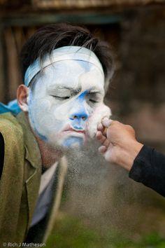 Guanjiang Shou (religious temple performer) powders his face, Taiwan