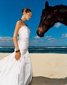 Beach wedding photography with horses. So beautiful