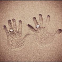 HANDS IN SAND WITH RINGSwedding day photo idea (definitely need someone w/an eye on the tide-L)