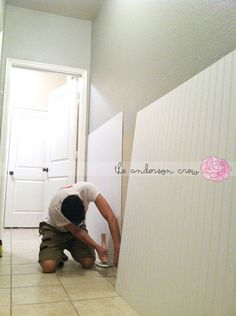 Easy Wainscoting.  10 foot piece at home Depot for $18: and they cut to your exact measurements for free! Add a chair rail and paint and you're done!