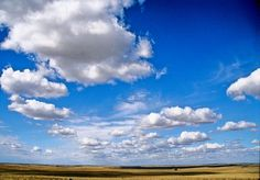 Fall Prairie Skies. White, bright clouds hang in the endless prairie sky.