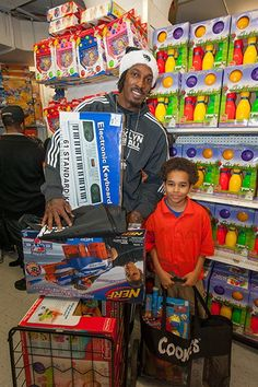 Brooklyn Nets take children impacted by Hurricane Sandy on holiday shopping spree.