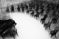 Chiharu Shiota Is a Japanese installation artist who creates interwoven structures that engulf objects in a tangle of yarn.