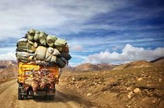 Catch a lift on the back of a overloaded truck ,lol