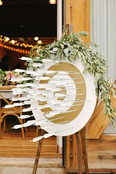 Creative seating chart with names and table numbers written on the fletches | 10 Archery Wedding Ideas We Love